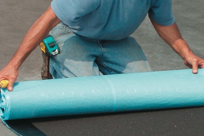 Perry Roofing Contractors in Gainesville Florida re-coating commercial roof.